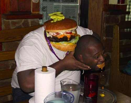 a burger with a human body eating a human head