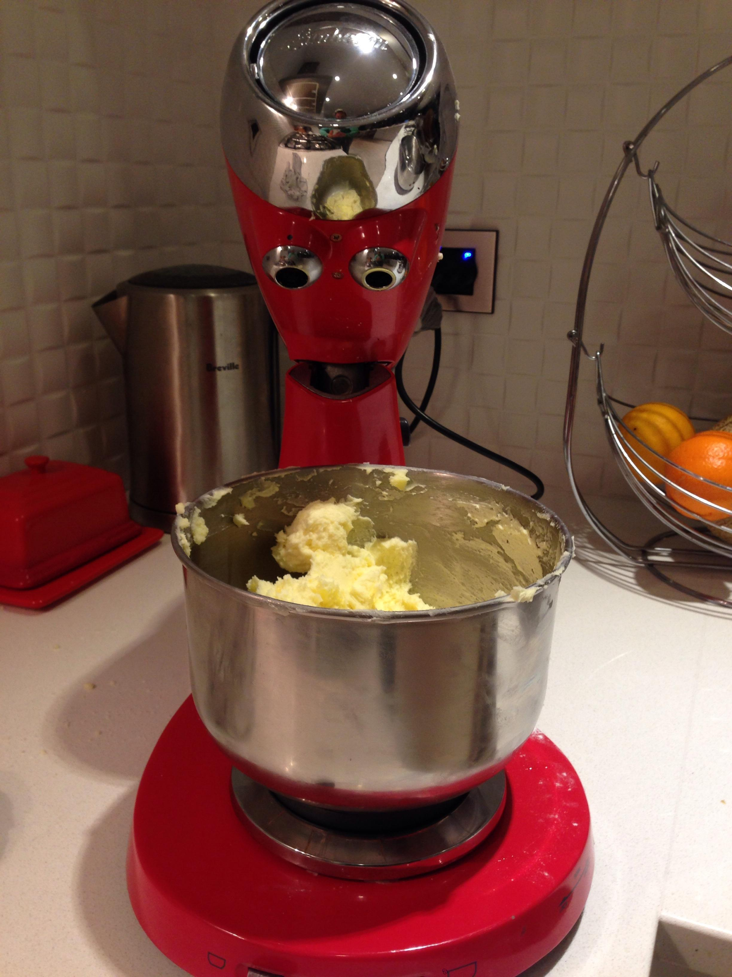 A stand mixer has an expression of despair on its face thinking what have i done